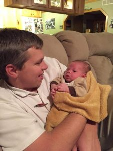 """CEO of Classic Buildings, Kenneth Miller with his newborn son on November 30th 2014""  Now this is a blessing indeed!"