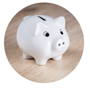 Piggy bank in a wooden table top.