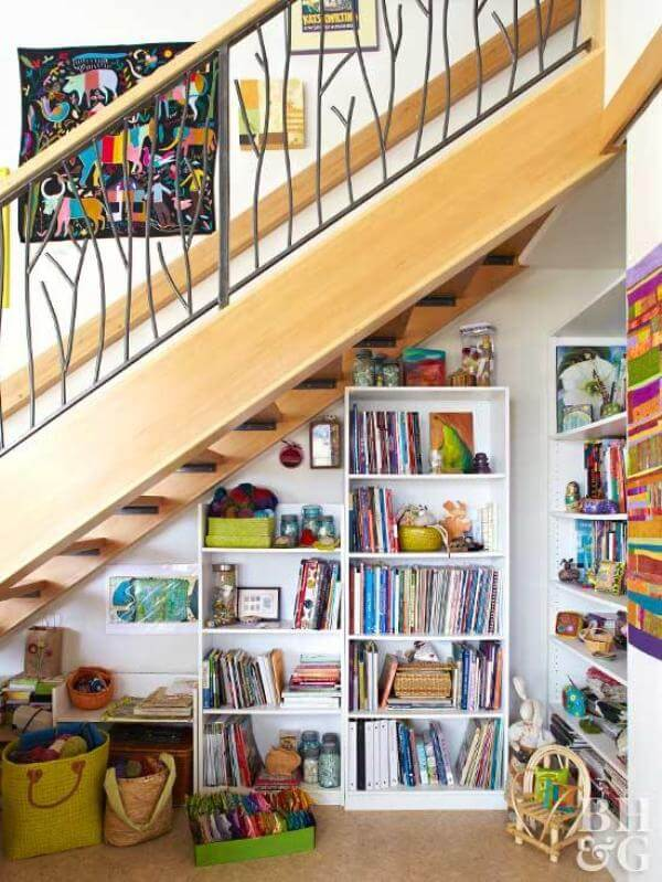 shelves and toys under the stairs